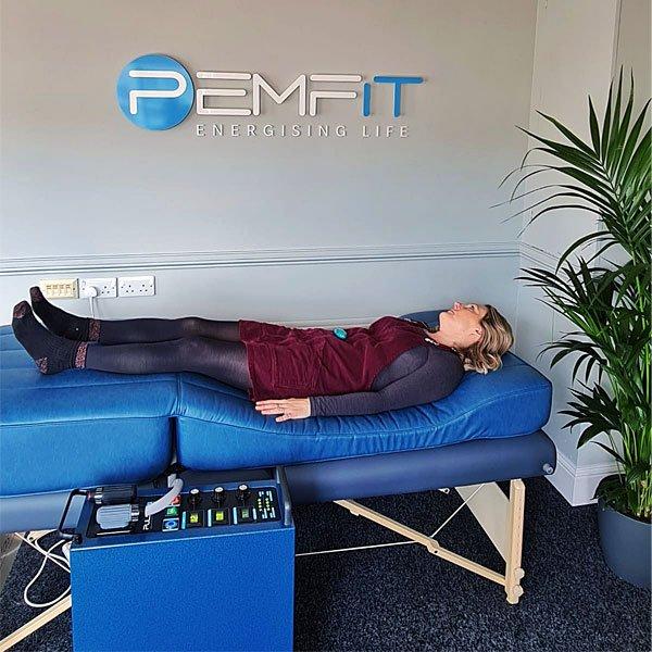 Woman-Lying-On-PEMF-Bed-At-PEMFiT