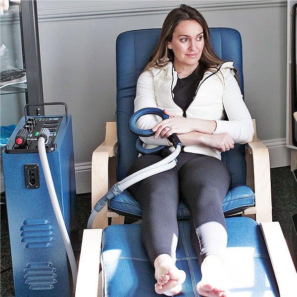 Woman-Sat-In-PEMF-Chair-Using-Rings-At-PEMFiT